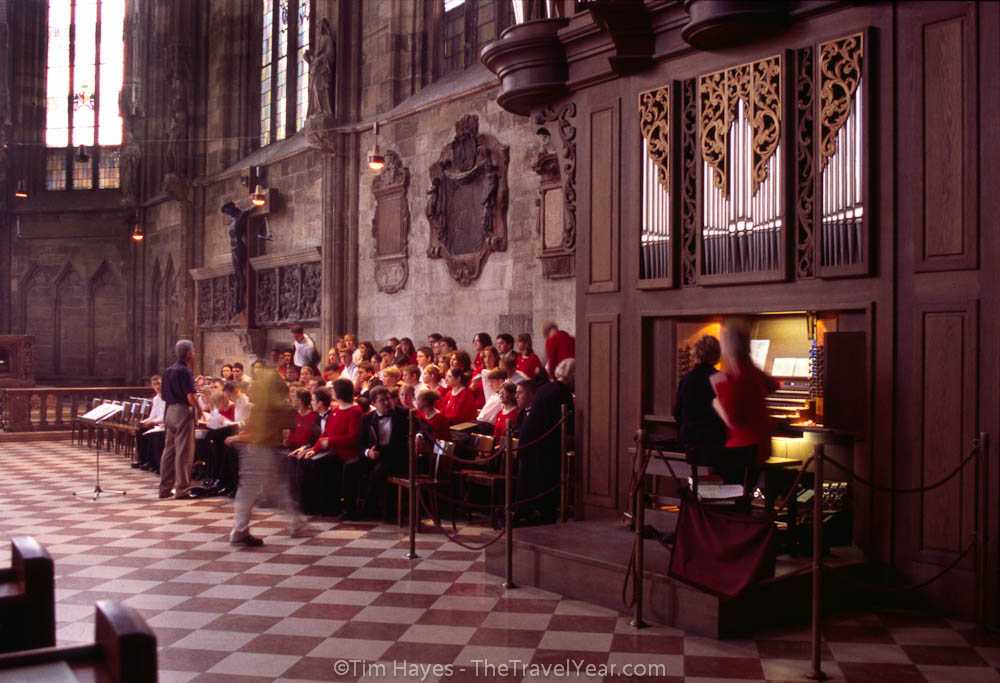 A choral group of young adults sings in Saint Stephan's (Stephansdom), a 13th century Gothic cathedral in the heart of old Vienna.