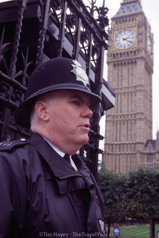 A bobby guards London's Big Ben and Houses of Parliament.