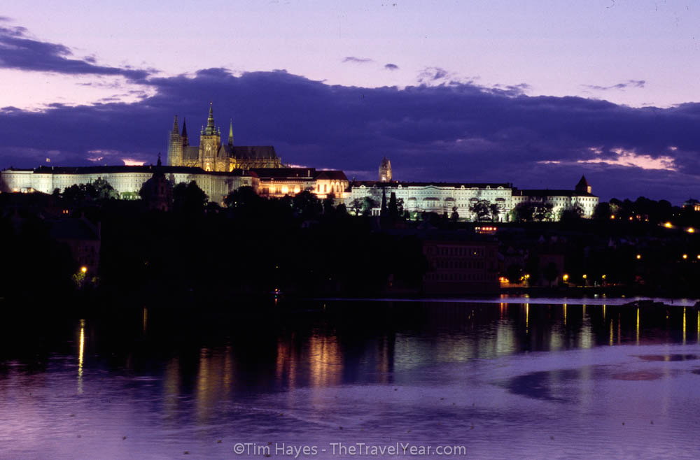 Evening falls over Prague Castle and the Vlatava River. The castle was built in the 9th century and is currently the official home of the Czech president.