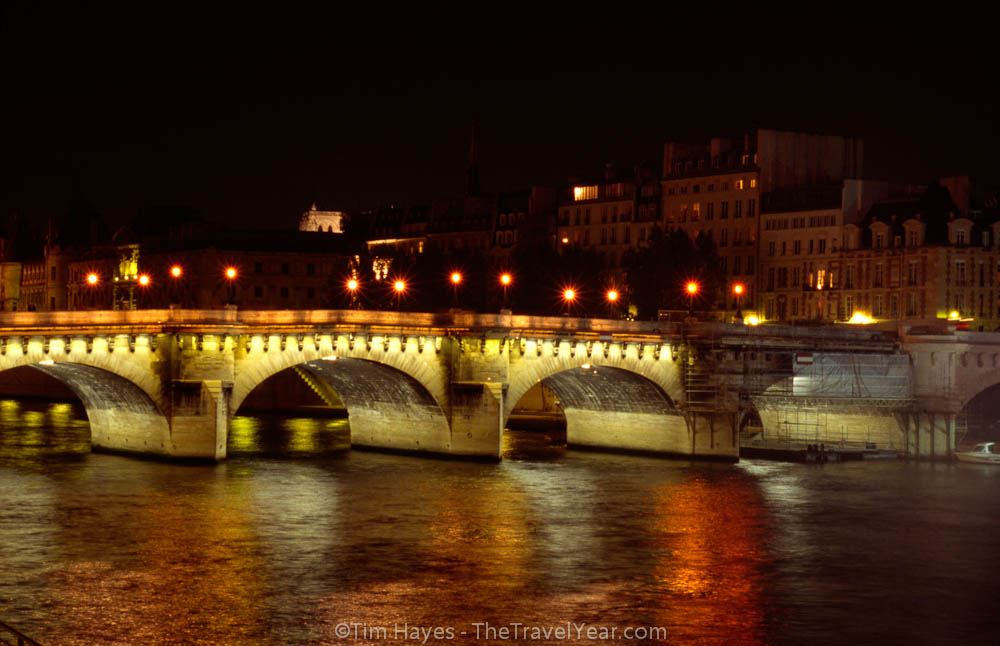 The Pont Neuf crossing the Seine in nighttime Paris.