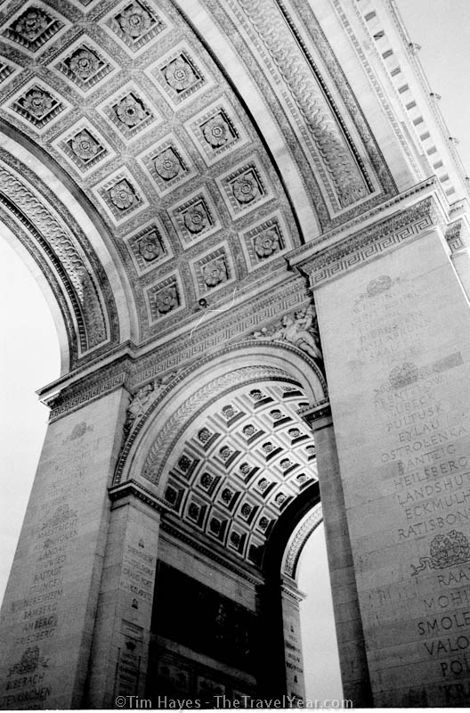 The Arc de Triomphe at the end of the Champs-Elysees in Paris, finished in the 1830s, now the final resting place of the World War I Unknown Soldier.