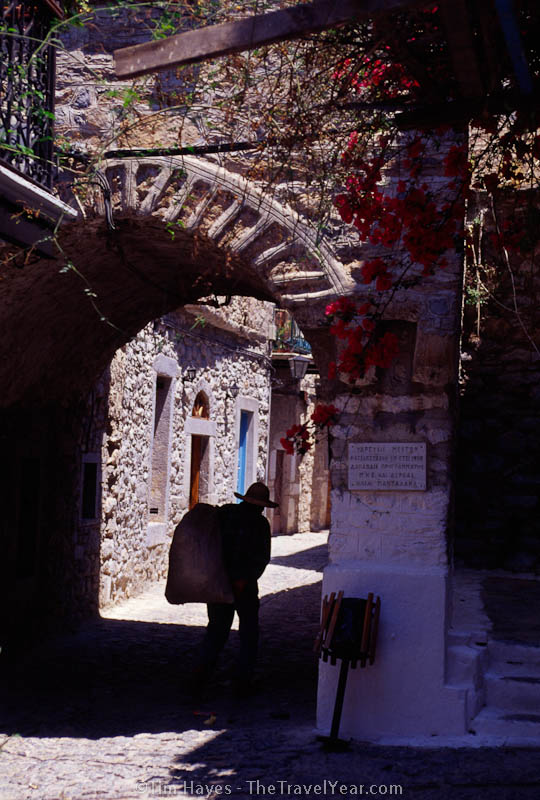 A man shoulders a bag through the medieval village of Mesta, southwest Chios. The streets of this well-preserved historic village were purposefully built in a mazelike manner to confuse invaders, which makes a casual stroll as a tourist all the more interesting.