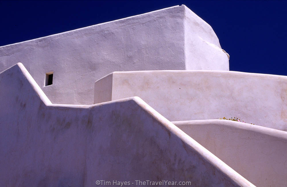 A blinding-white home in the strong sun of Folegandros, a quiet less-visited island in the Greek Cyclades.