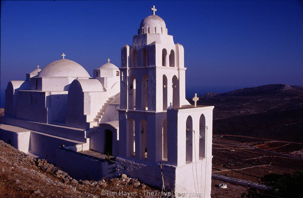 A Greek church overlooking the dry rocky fields of Folegandros. This slow-paced Cyclades island is visited far less than its touristy island neighbors and sizes up at a mere 32 square kilometers.