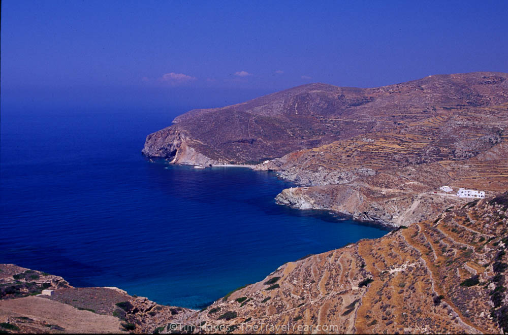 Deep Aegean blue water stands in contrast to the dry hills of Folegandros. This slow-paced Cyclades island is visited far less than its touristy island neighbors and sizes up at a mere 32 square kilometers.