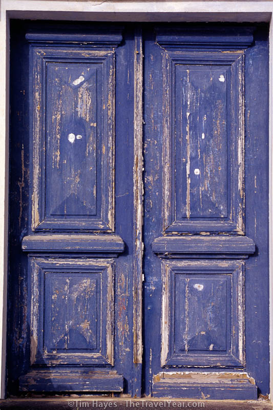 A weathered doorway in Ia, a picturesque town located in the Greek Cyclades island of Santorini.