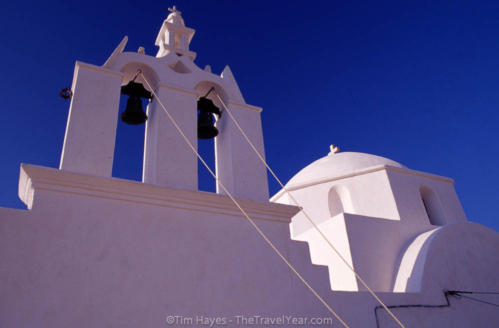 Greek church bells from the Pantanassa Church on Folegandros. This slow-paced Cyclades island is visited far less than its touristy island neighbors and sizes up at a mere 32 square kilometers.