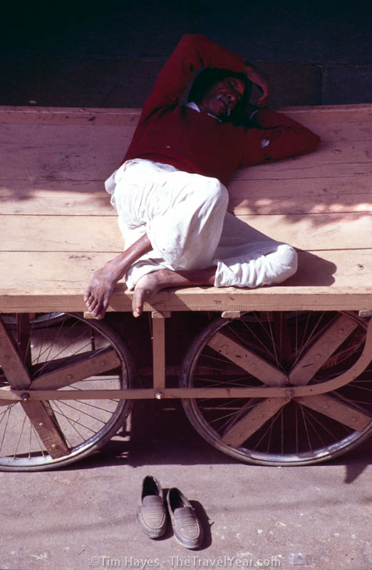A man takes an afternoon nap on his push cart in Pushkar.