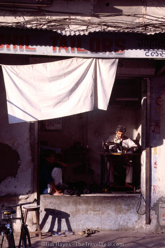 A tailor stitches clothes in India's Mt. Abu.