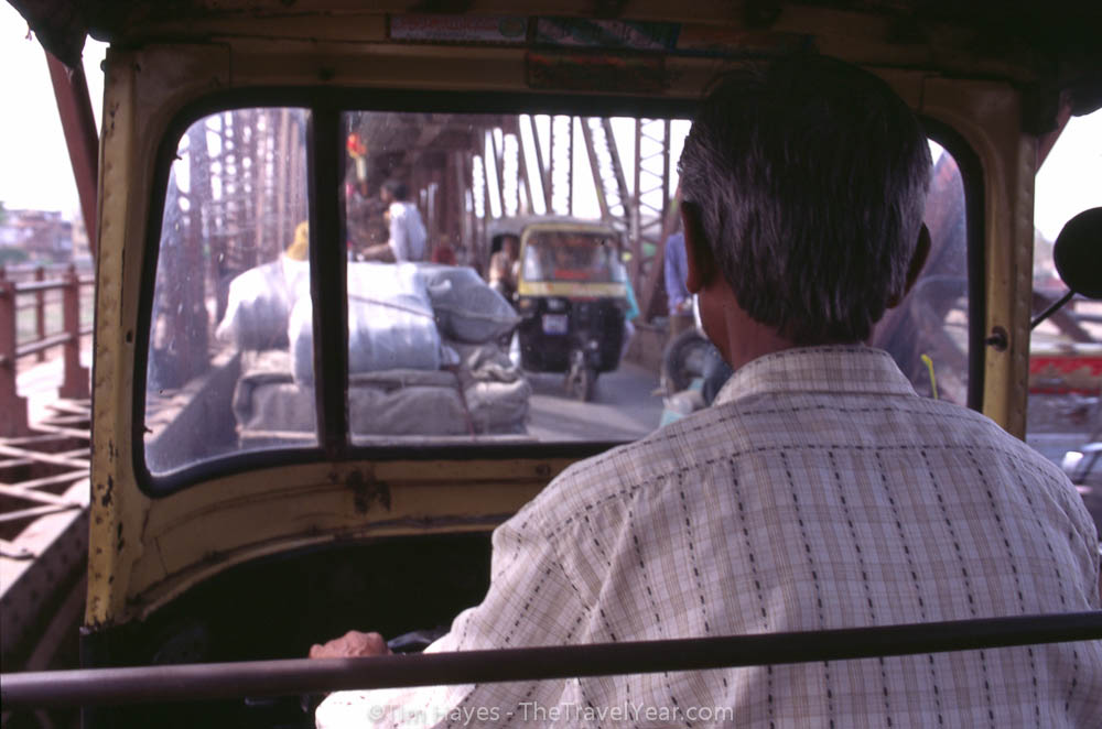 A view from the back of an Indian auto-rickshaw in Agra.