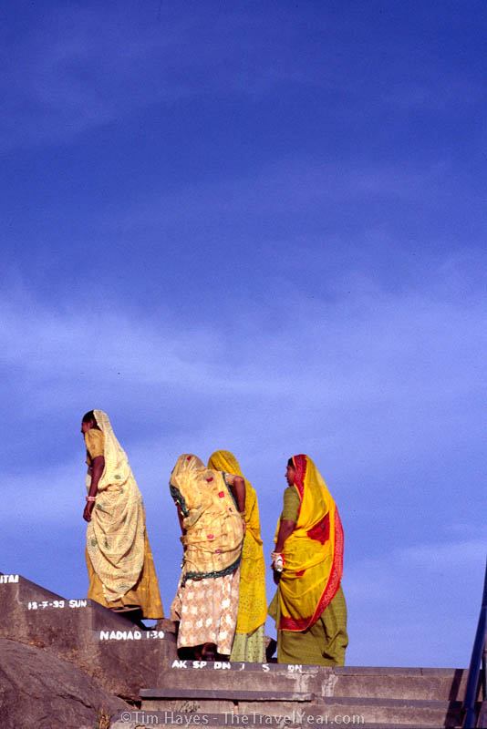Women in colorful saris climb the 365 stairs up to the top of the Hindu Adhar Devi temple near Mt. Abu.