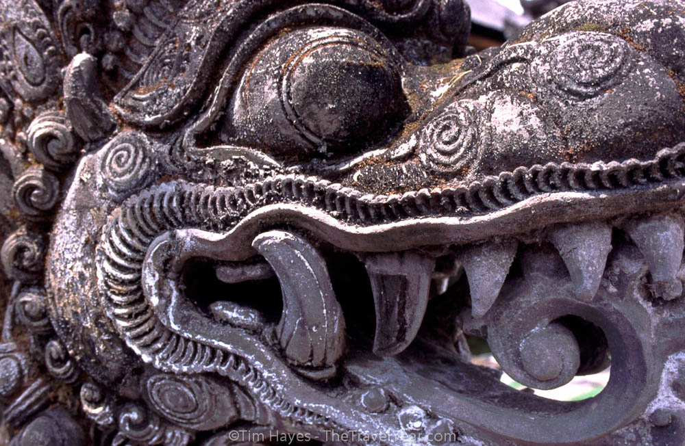 A carving guards the entrance to a temple in Bali.