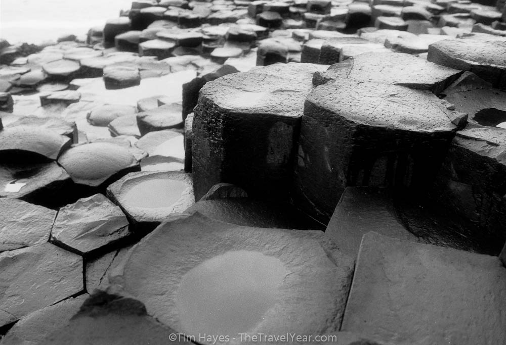 The unusual rock formations of the Giant's Causeway in Northern Ireland, a mass of 40,000 basalt columns created by cooling lava.