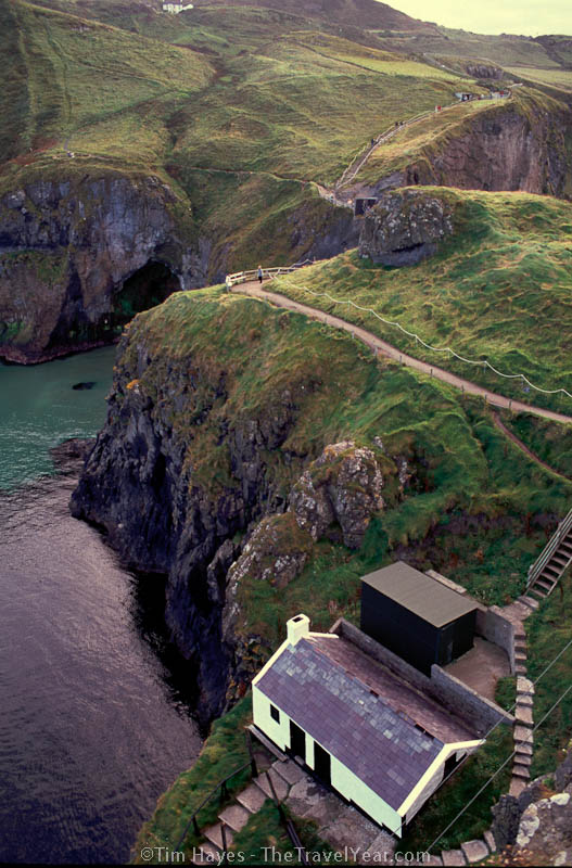A small home on the Antrim Country north coast island of Carrick-a-rede.  The island is connected to the mainland by a small rope bridge that dangles high over the water.