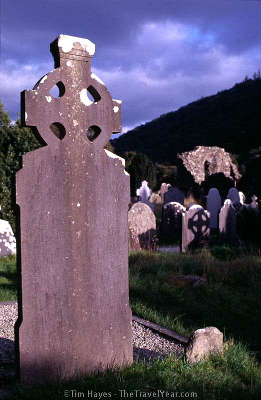 A Celtic cross headstone in a graveyard near the Glendalough Monastery. The monastery was founded during the sixth century and remained active until the sixteenth century.
