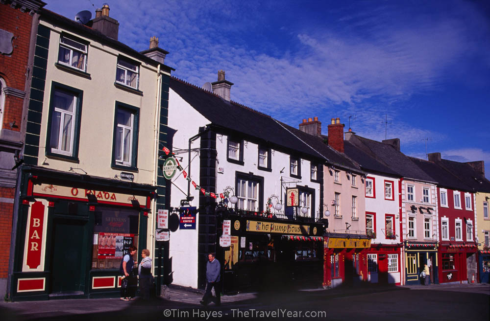 Traditional Irish pubs line a street in the quaint town of Kilkenny.
