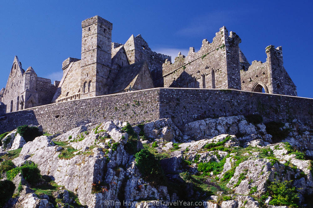 The stone wall and historic gothic structures of the Rock of Cashel.