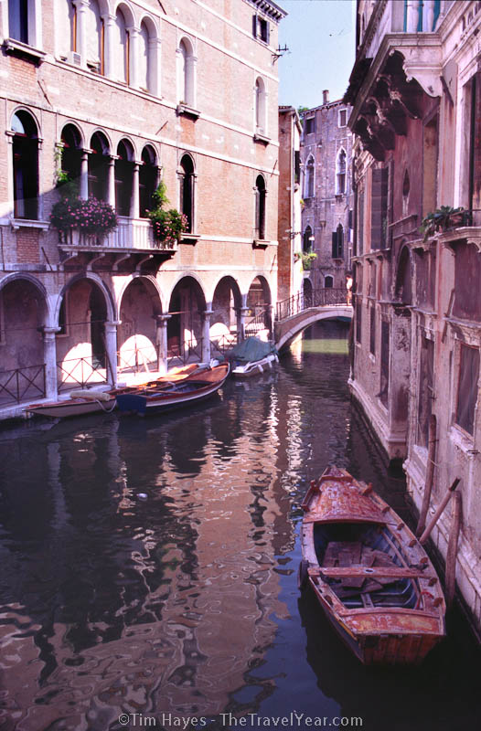 Classic Venetian buildings line a small canal in the back areas of the city.
