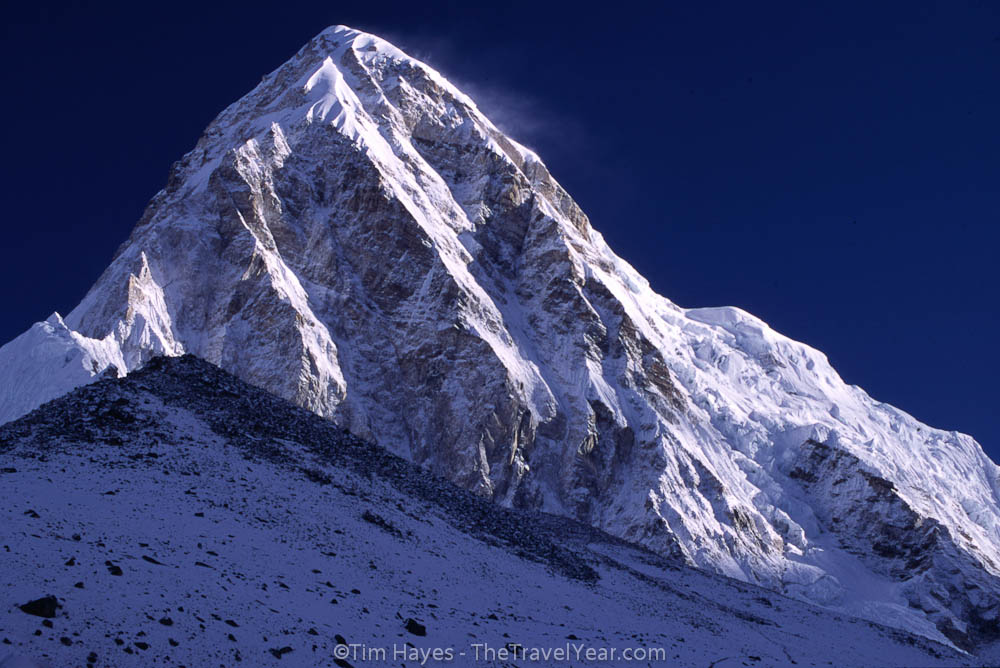The majestic peak of Pumori stands at 7161 meters (23,494 feet), rising almost 1500 meters higher than the peak of Kala Pattar below it.