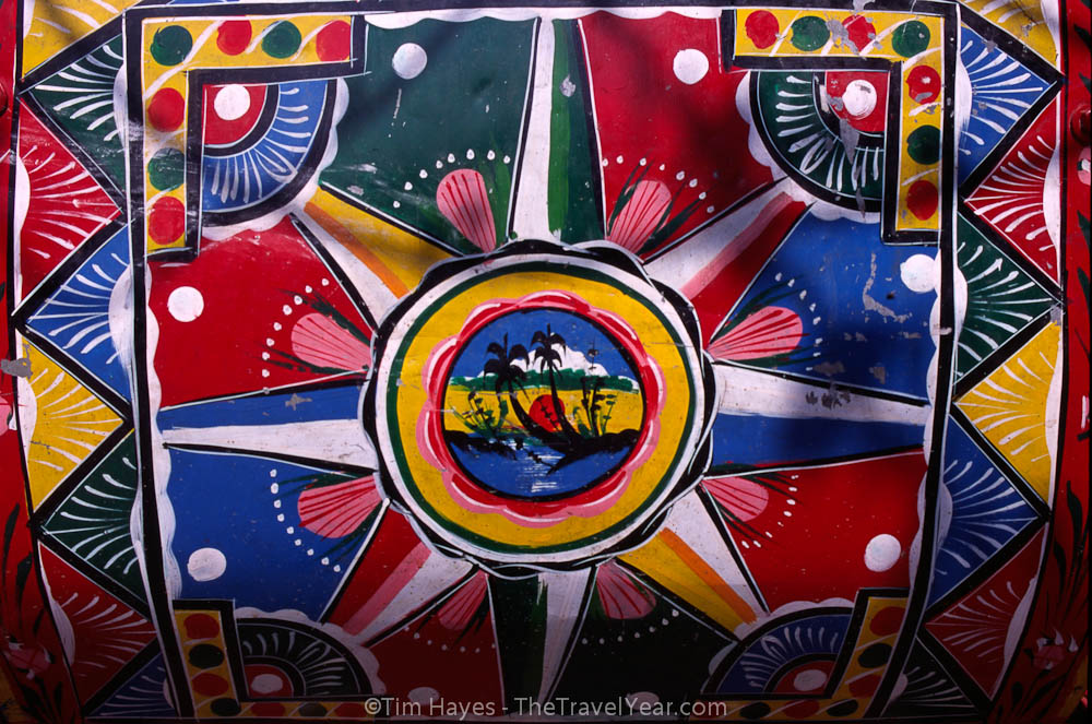 Colorful decorations adorn the back of a Nepalese rickshaw.