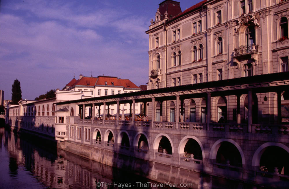 The facade of Ljubljana's produce market lies adjacent to the picturesque Ljubljanica River.