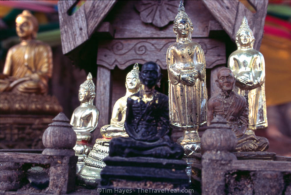 Statuettes of revered monks and Buddha adorn the Suan Dawk temple in Chiang Mai, Thailand.
