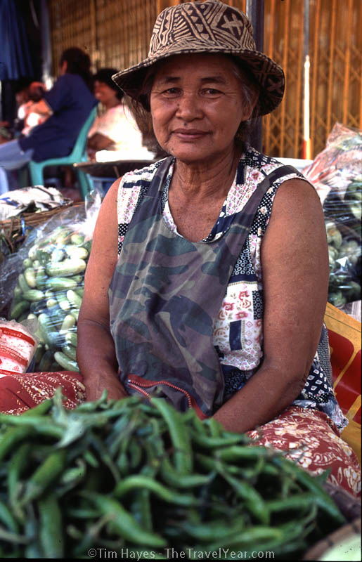 A Thai woman sells vegetables on street in Sukhothai.