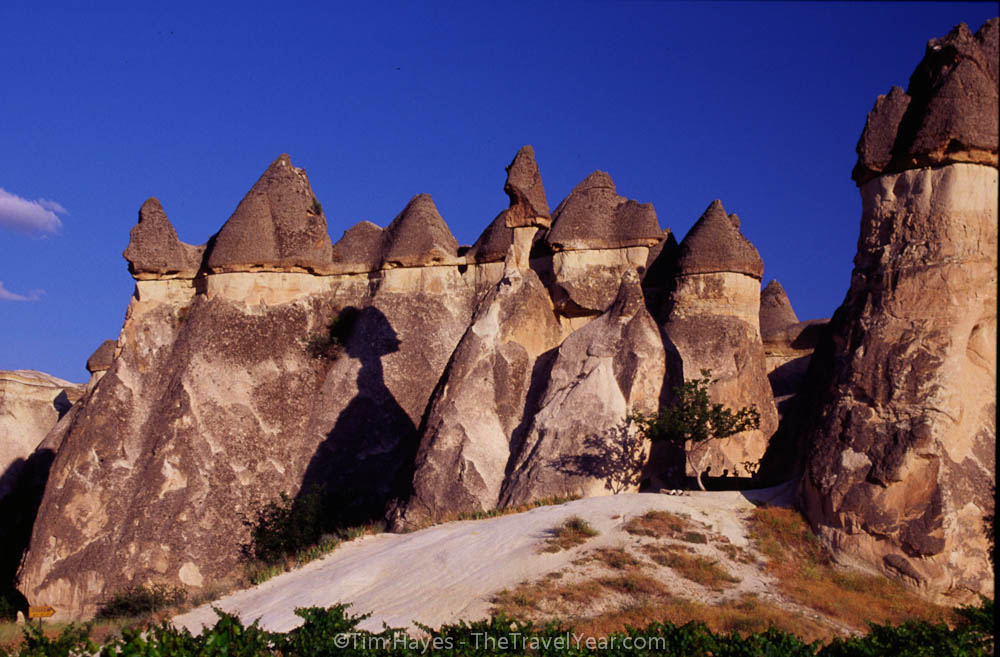 The unusual rock formations of Turkish Cappadocia, formed by differential erosion between a top layer of hard rock and a bottom layer of soft stone. The soft stone, called tuff, is made of volcanic ash from an eruption some 10 million years ago.