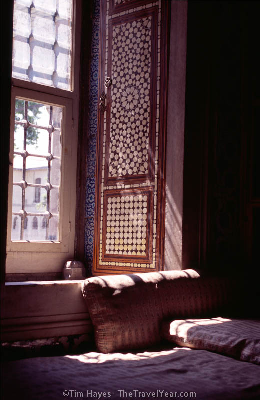 Sun filters across Turkish tile work and mother-of-pearl doors in the Topkapi Palace, Istanbul's home of the sultans.