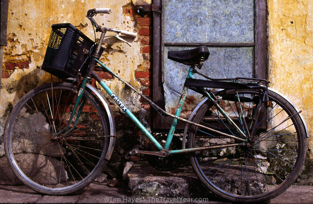 The ever-present Chinese bicycle sits against a wall in the picturesque Vietnamese town of Hoi An.