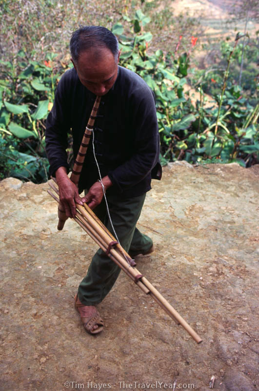 A hilltribe musician in Bac Ha, northern Vietnam, plays a haunting tune on his home-made instrument.
