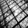 Architect I.M. Pei's glass pyramid, a new addition to the Louvre Museum (Le Musée du Louvre), presents a striking contrast to the rest of the museum's classical look.
